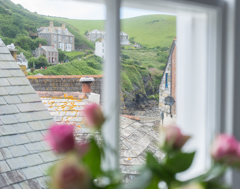 Harbour and hillside views from the double bedroom of Bre Cottage