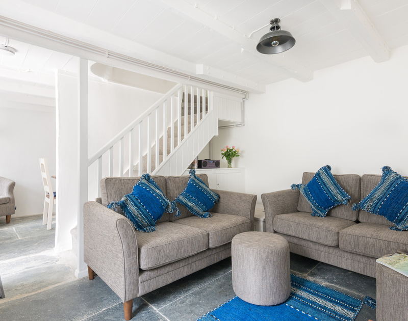 This holiday cottage combines traditional slate flag stone flooring and modern style at Bre Cottage in Port Isaac, North Cornwall