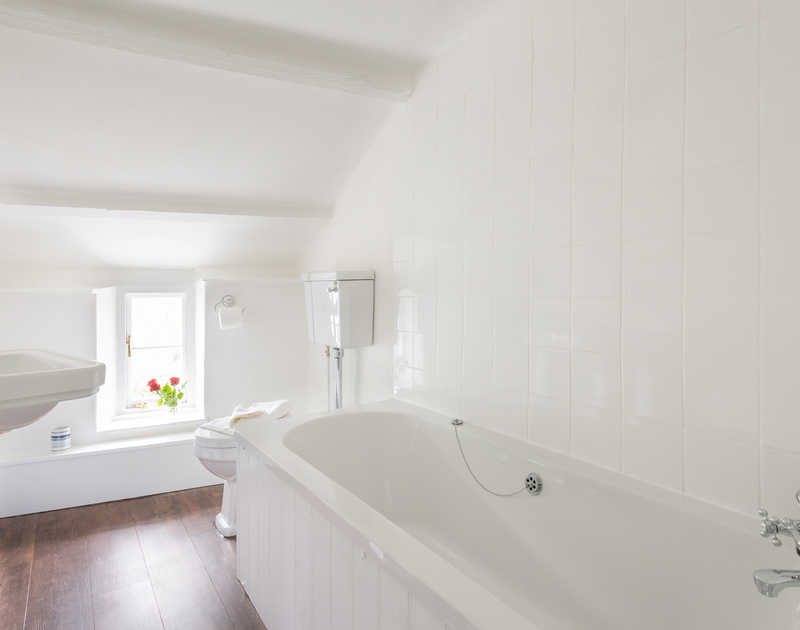 Fresh white ensuite bathroom next to the twin bedroom at Bre Cottage, holiday accommodation in Port Isaac