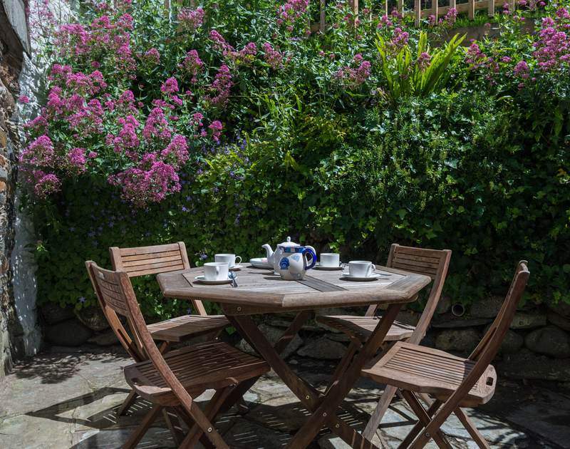 The sunny terrace is the ideal place to indulge in a proper Cornish Cream Tea or an open air family meal at Poplar a self catering holiday property in the heart of the village of Port Isaac.