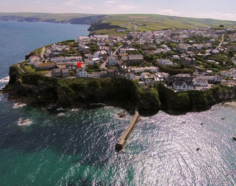 A drones view showing the fantastic location on the cliffs of Beehive Cottage, a self catering holiday house in Port Isaac, Cornwall.