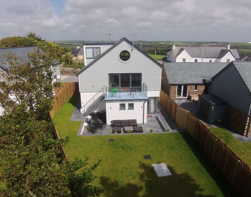 An elevated view of Appleby showing the garden and balcony of this lovely new self catering holiday home within walking distance of Daymer Bay and Polzeath beaches, the shops and the pubs and restuarants, Cornwall