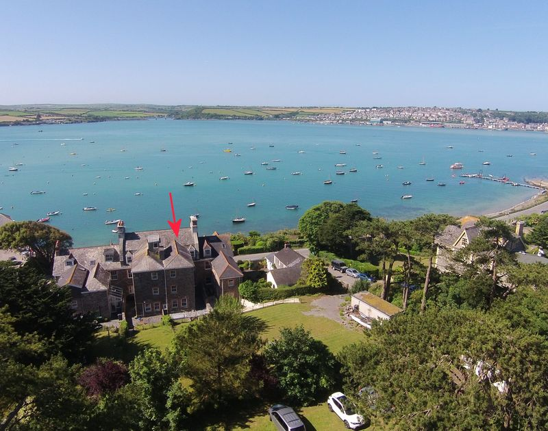 An aerial rear exterior view of 4, The Terrace and gardens, a self catering,waterside holiday house taken from the Camel Estuary in Rock, North Cornwall.