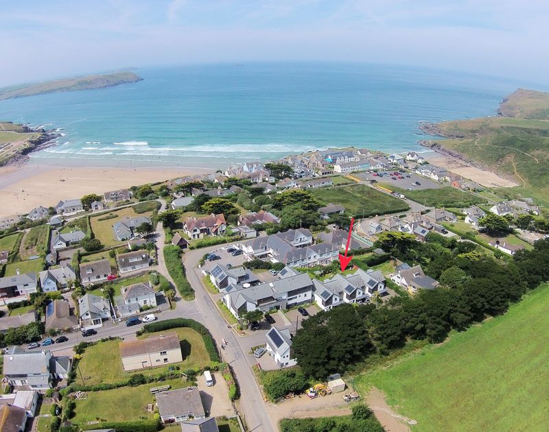 An aerial drone shot of the location of Borlase a self catering holiday house in Polzeath, Cornwall