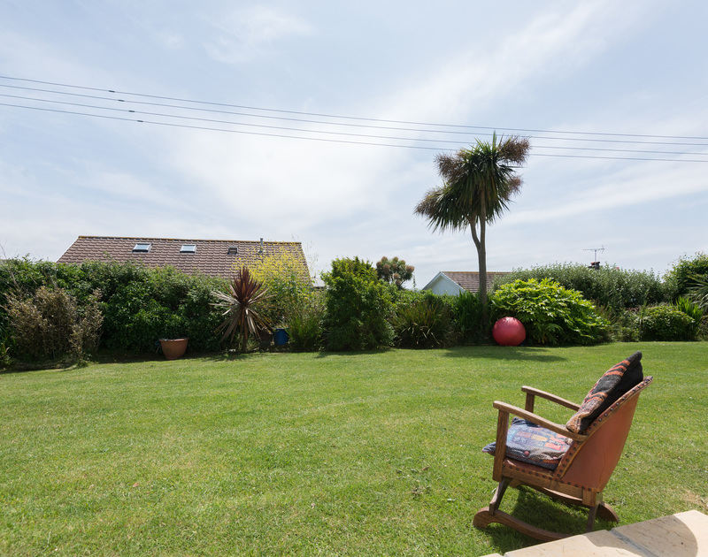 Good sized communal lawn for relaxation, picnics or games at self catering, holiday apartment Polzeath Court 1, close to the beach and village at Polzeath.