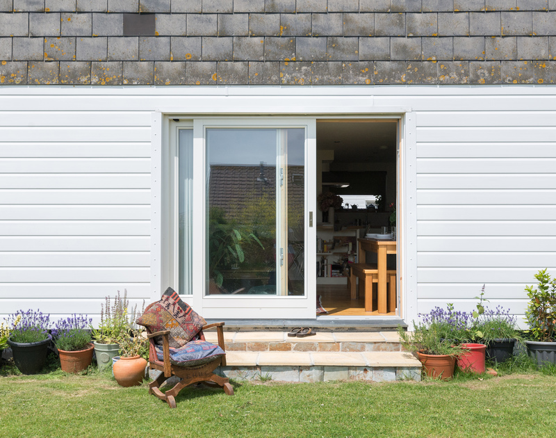 The exterior of self catering holiday apartment Polzeath Court 1 taken form the communal gardens in Polzeath North Cornwall.