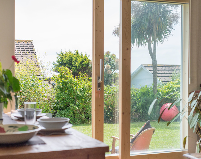 Open the glass sliding doors from the living room at Polzeath Court 1, and enjoy the sea breezes on balmy holidays in North Cornwall.