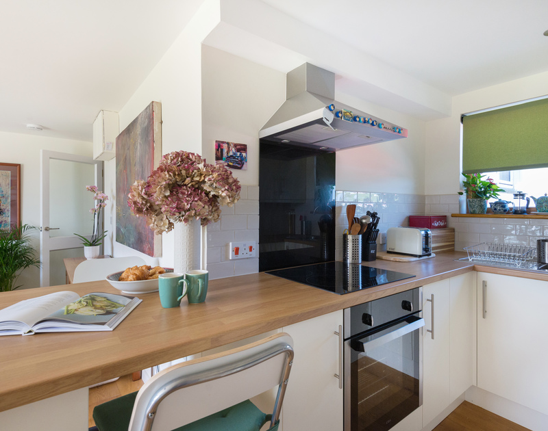 The kitchen at Polzeath Court 1, a self catering, holiday apartment in Polzeath, an ideal retreat for couples or a small family.