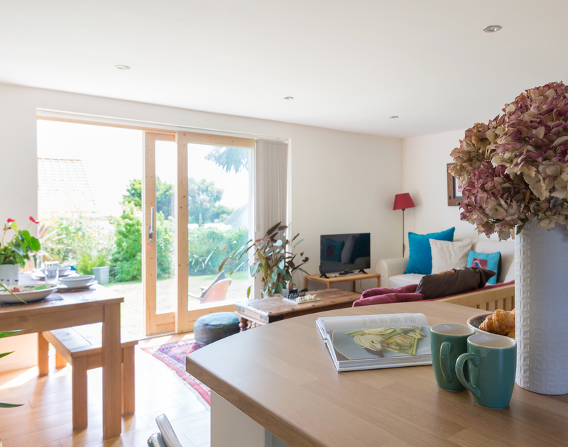 The open plan living areas in south facing, self catering holiday apartment Polzeath Court 1 on the North Coast of Cornwall.