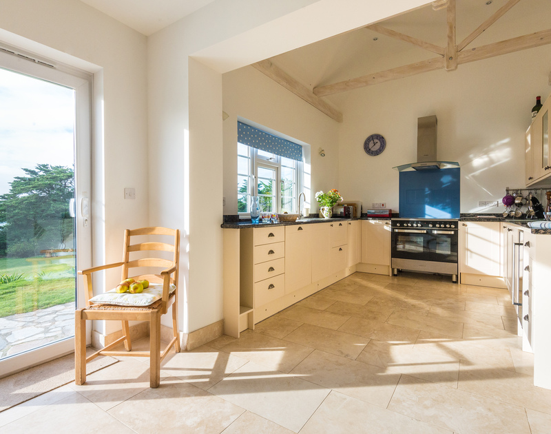 The spacious and sunny kitchen/breakfast room of Doom Bar House, a holiday rental at Daymer Bay, Cornwall