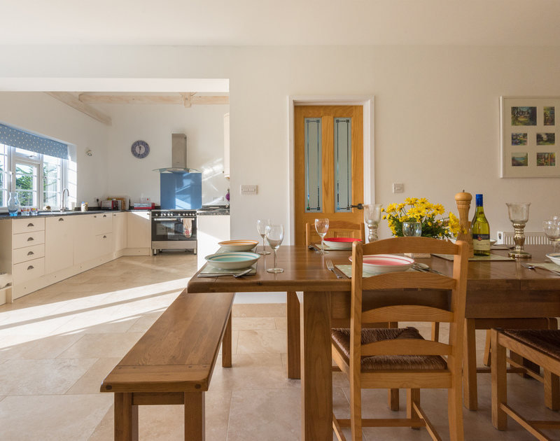 The spacious and light open plan kitchen/dining room of Doom Bar House, a holiday house at Daymer Bay, Cornwall