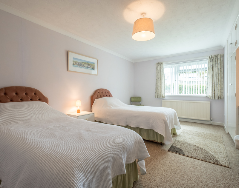 The spacious twin bedroom at self catering holiday rental Bahari in Rock, north Cornwall.
