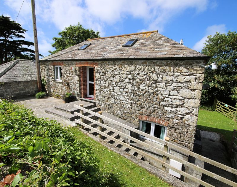 The rear exterior view of An Skyber Barn, a traditional self catering holiday cottage in Trelights which is in-between Port Isaac and Polzeath,in North Cornwall.