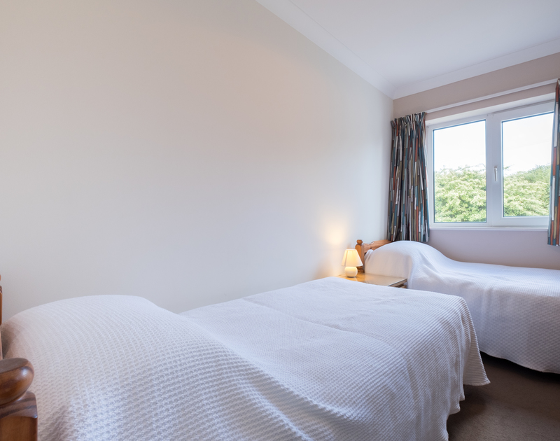 The twin bedroom 2 at Cogenhoe overlooks the front of this newly refurnished holiday property in Rock, Cornwall