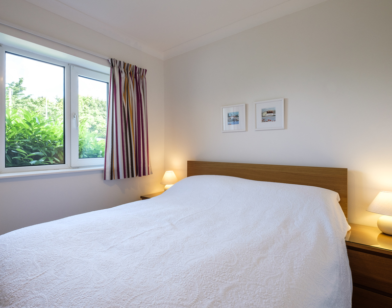 Bedroom three at Cogenhoe offers a kingsize bed overlooking the front garden and shared use of the family bathroom