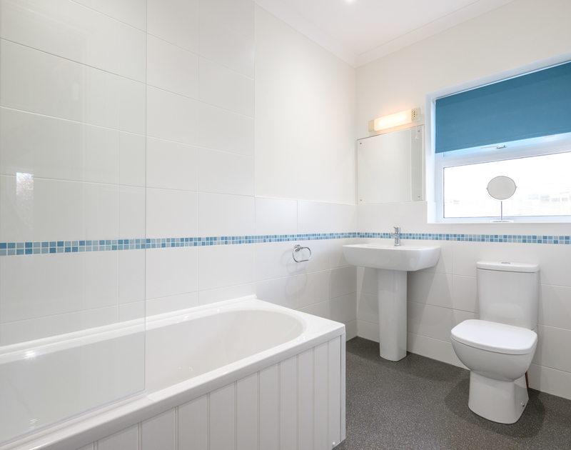 The newly refurbed family bathroom at Cogenhoe in Rock, Cornwall has an over the bath shower