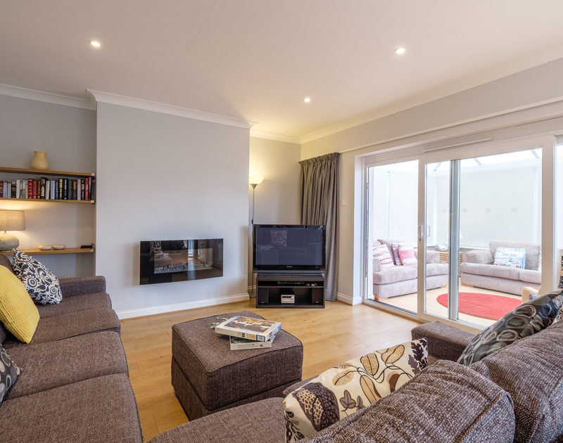 The newly modernised sitting room in Cogenhoe, in Rock on the north coast of Cornwall has a contemporary gas fire and relaxed feel.