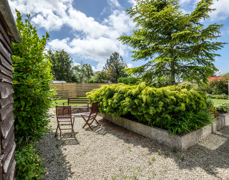 Sunbathe or retreat to a cool spot to read a book in the large mature gardens at Cogenhoe, a family holiday cottage in Rock.