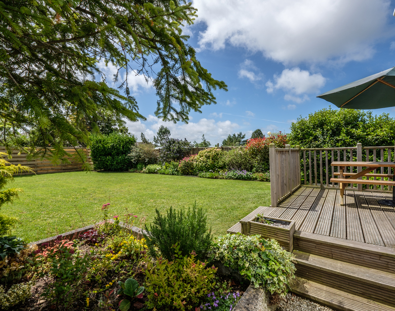Enjoy playing and dining outdoors in the pretty mature back garden at Cogenhoe in Rock, Cornwall