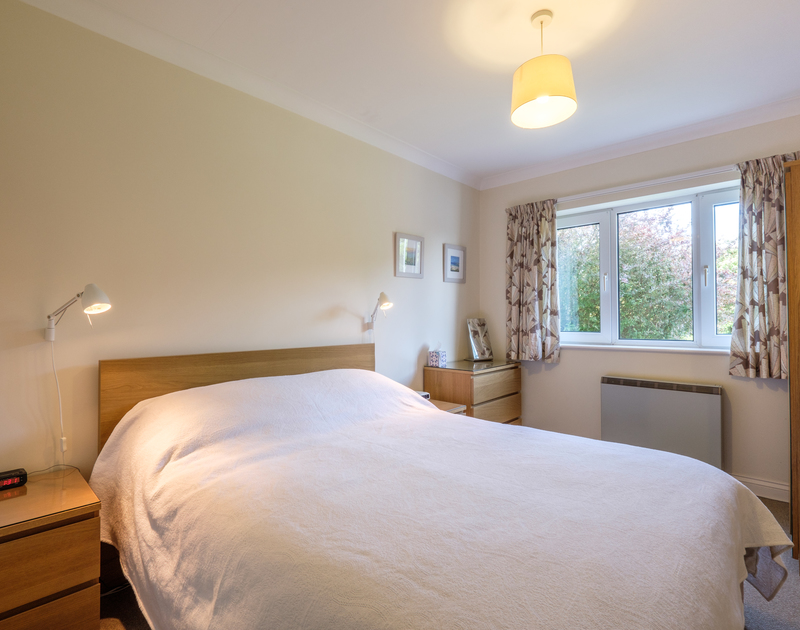 The king size master bedroom at Cogenhoe, in Rock, Cornwal overlooks the front garden and has an ensuite shower room