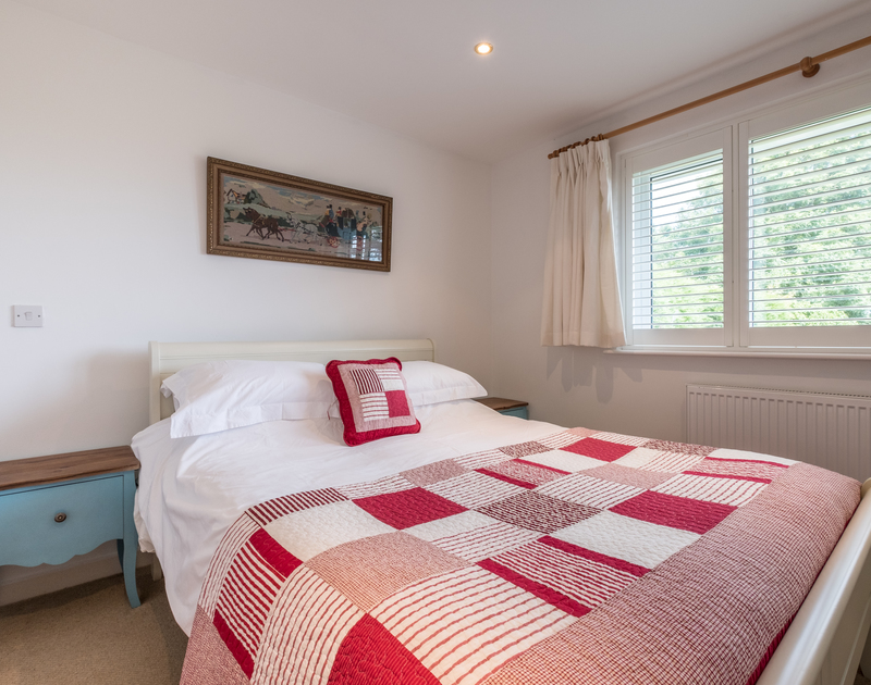 A comfortable double bedroom at Trestar, a self catering, family holiday home in Polzeath.