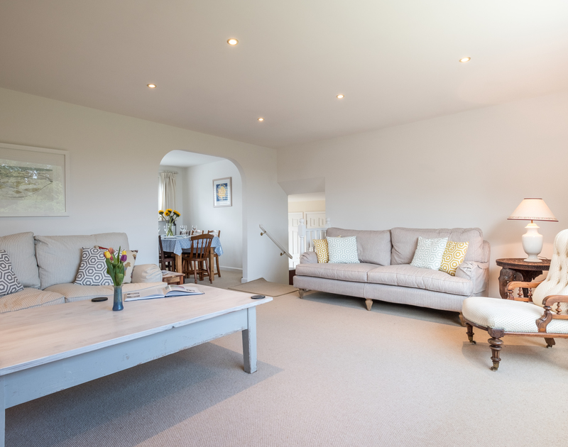 The spacious sitting room at self catering holiday home to rent Trestar in Polzeath, North Cornwall.