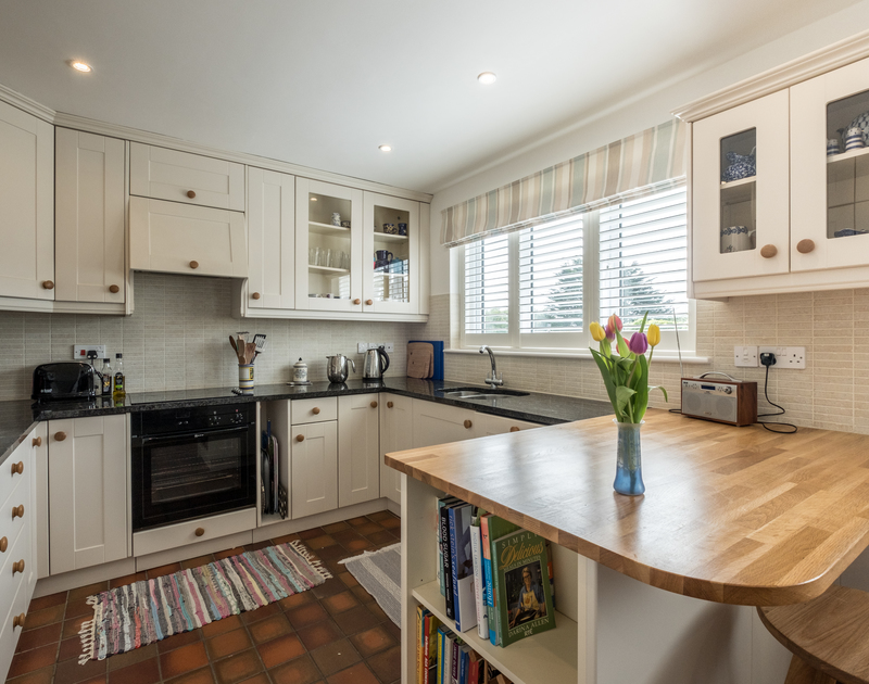 Modern kitchen with plenty of work surfaces to prepare family meals at self catering holiday house Trestar in Polzeath.