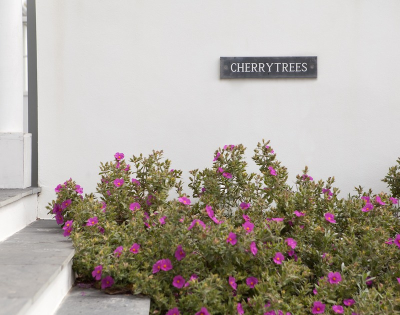 Holiday makers at Cherrytrees in Rock, are welcomed to the front door by flowering plants and slate steps.