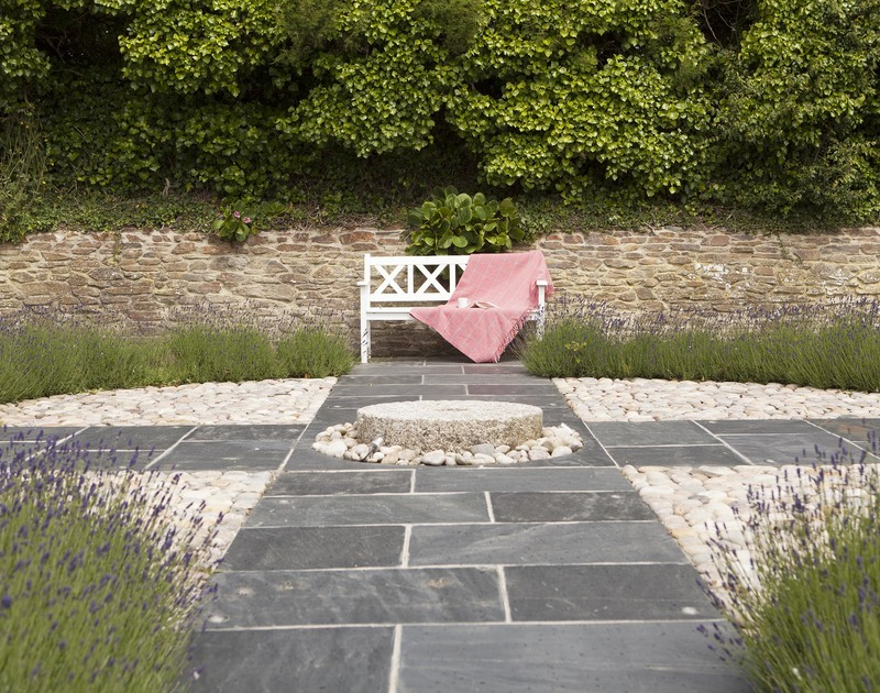 The pretty sundial on the rear terrace at Cherrytrees, a luxury holiday home to rent in Rock, Cornwall.