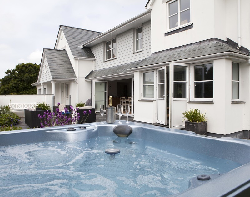 The hot-tub and the exterior of Cherrytrees, a contemporary holiday house to rent in Rock, North Cornwall.
