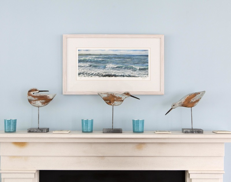 Seaside touches and decorations above the woodburner in the cosy living room at Cherrytrees, a luxury holiday cottage in Rock, Cornwall