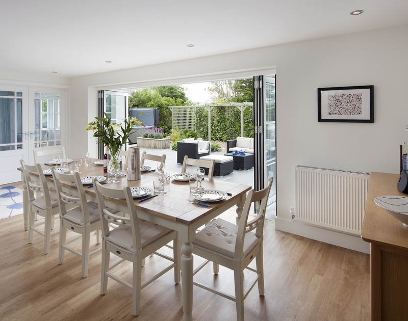 The open plan dining room in Cherrytrees in Rock, opens up to the stone terrace and adjoining sitting room