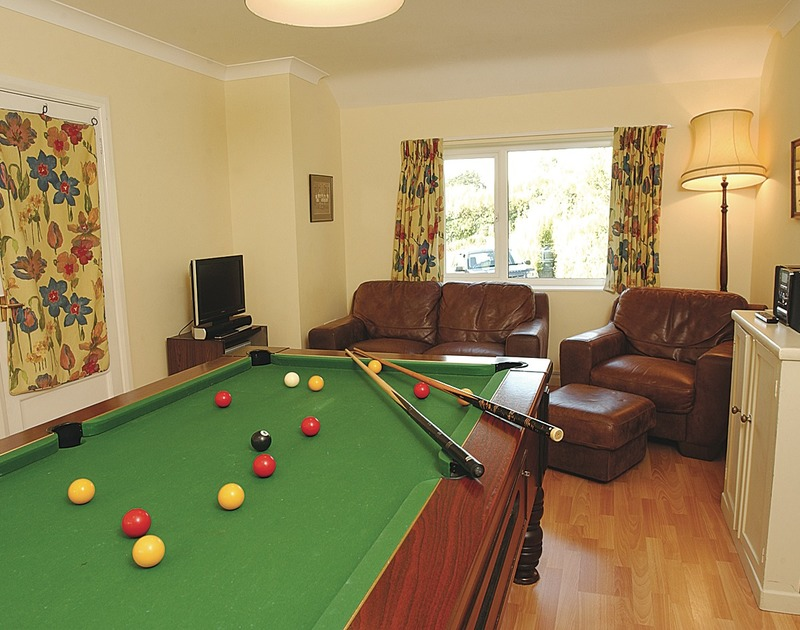 The pool table in the games room of Tamarisk, a self-catering holiday rental in Rock, Cornwall