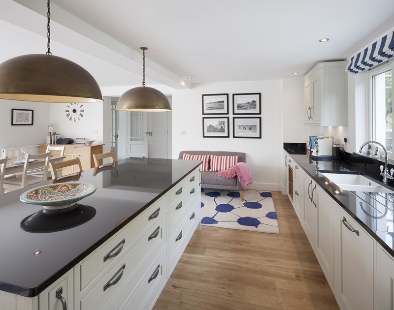 The contemporary open plan kitchen in Cherrytrees, a self catering holiday house to rent in Rock, North Cornwall.