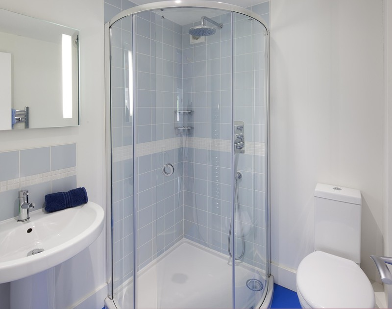 A bright, modern shower room, one of four at self catering holiday house Cherrytrees in Rock, North Cornwall.