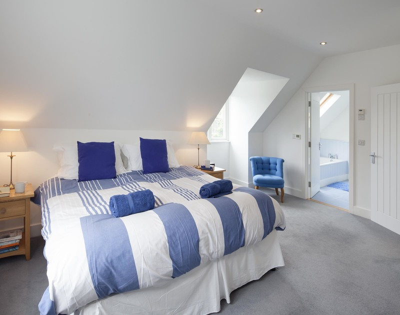 The spacious master bedroom with en-suite bathroom in Cherrytrees, a self catering holiday house to rent in Rock, Cornwall.