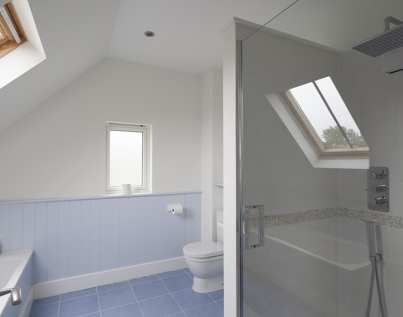 Painted in soft blue shades the master en-suite at Cherrytrees in Rock has both a bath tub and walk in shower