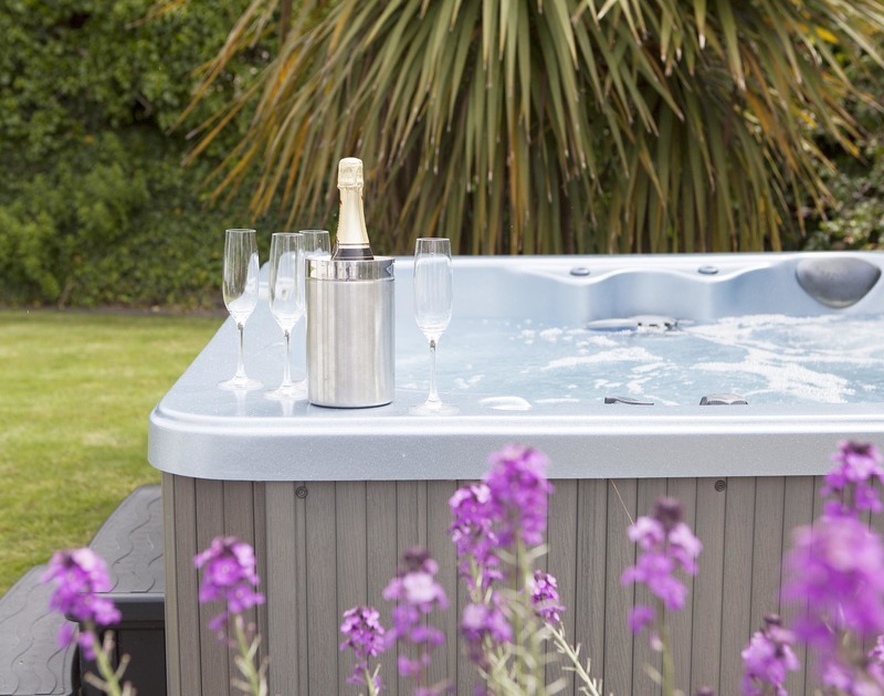 Count the stars as you relax and unwind in the hot tub and pretty garden at Cherrytrees in Rock, north Cornwall
