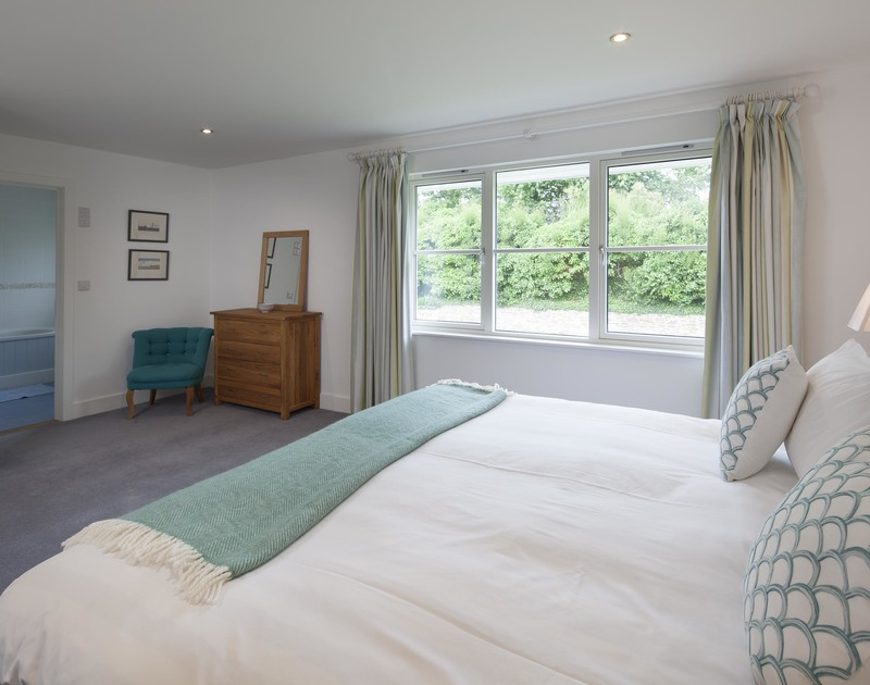 The spacious superking en-suite bedroom at Cherrytrees in Rock, north Cornwall overlooks the landscaped rear garden