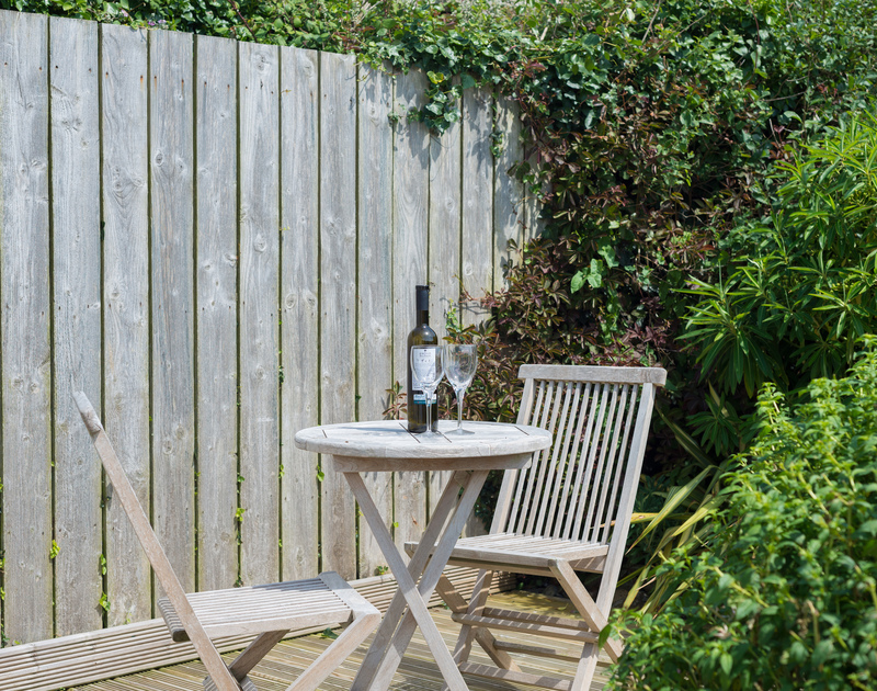 A sheltered spot for a glass or two of wine in the garden at self catering holiday property The Point.
