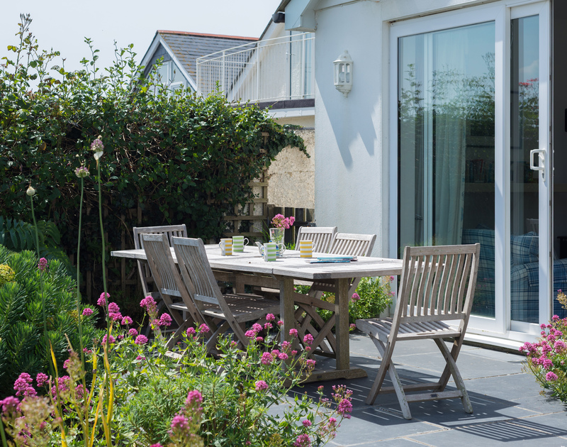 Take your family meals outside to the large garden table on the terrace at self catering holiday house The Point.