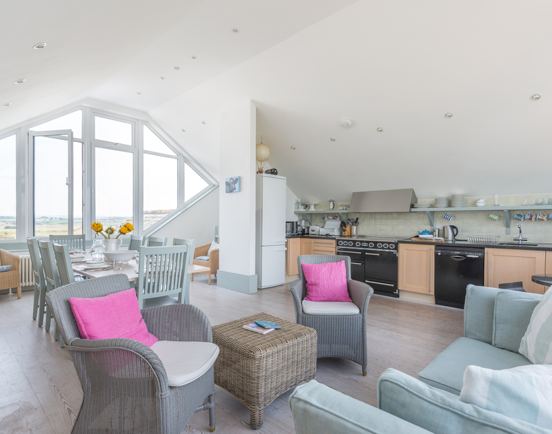 Modern, open-plan kitchen at The Point, a self-catering holiday house in Polzeath, Cornwall