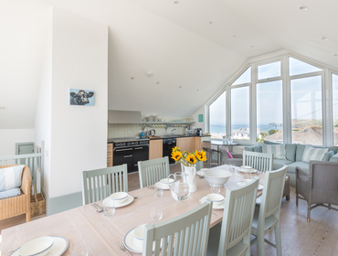 Sea views can be found at the end of the dining table at The Point in Polzeath.