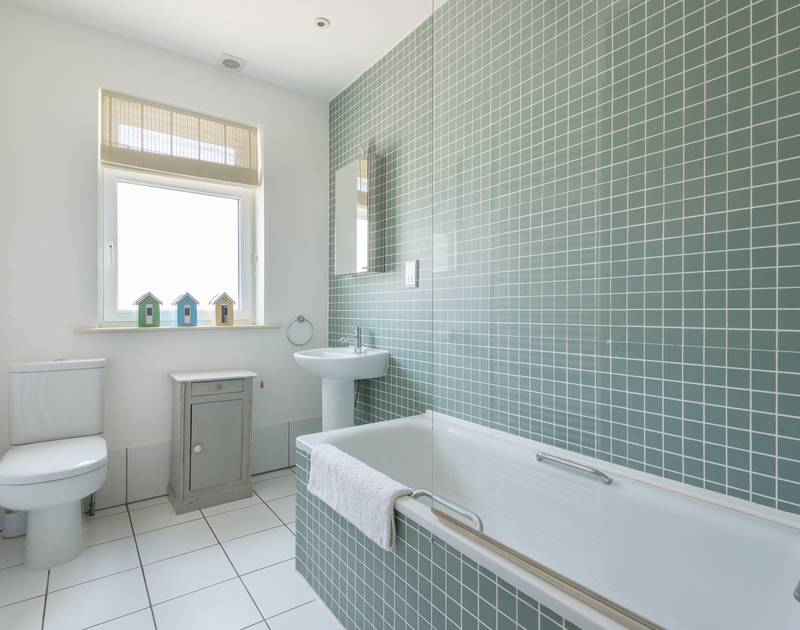 Sleek, modern bathroom at The Point, a self-catering holiday house at Polzeath, North Cornwall