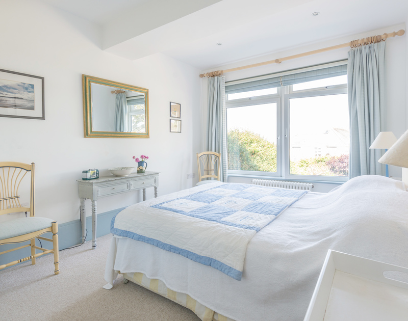 Master bedroom at self catering, seaside holiday house The Point at Polzeath in north Cornwall.