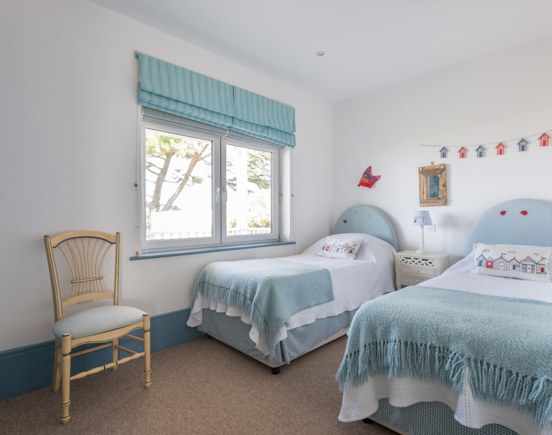 One of two twin bedrooms at self catering, holiday rental The Point at Polzeath.
