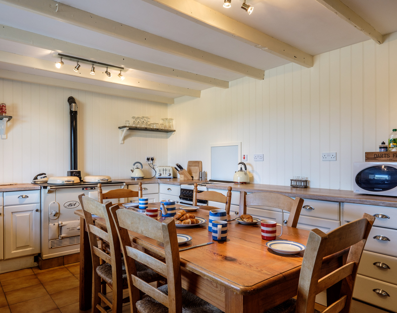 The welcoming family kitchen at Trewint Farmhouse, a self catering holiday rental near Daymer Bay in North Cornwall.