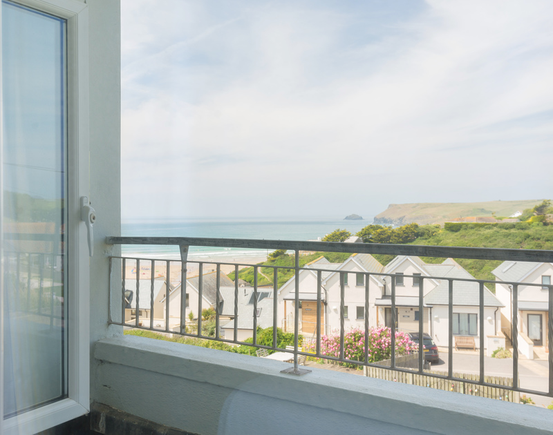 Coastal views from one of the bedrooms at Treverbyn a self catering, holiday house to rent in Polzeath, Cornwall.