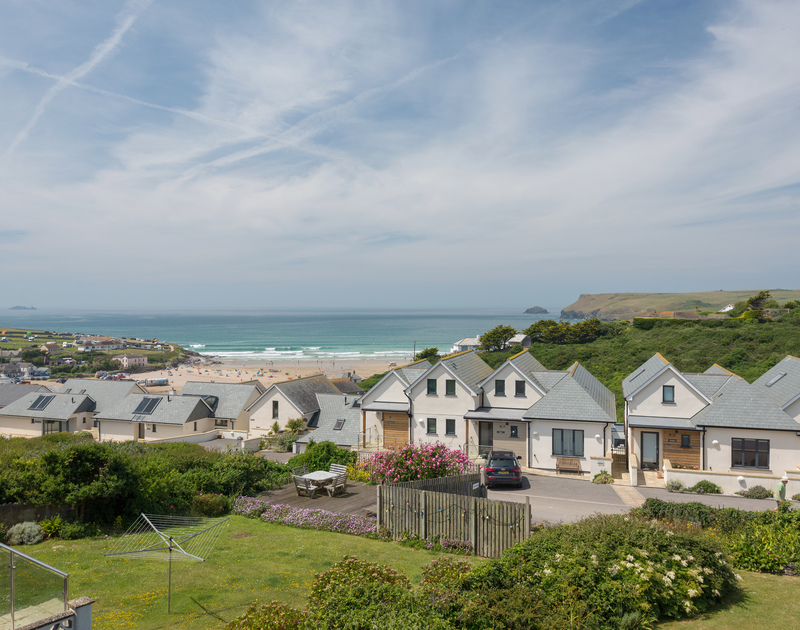 Look down the garden and out to sea where you can watch the waves roll in over the beach at Polzeath from the bedroom window at self catering, holiday house Treverbyn.