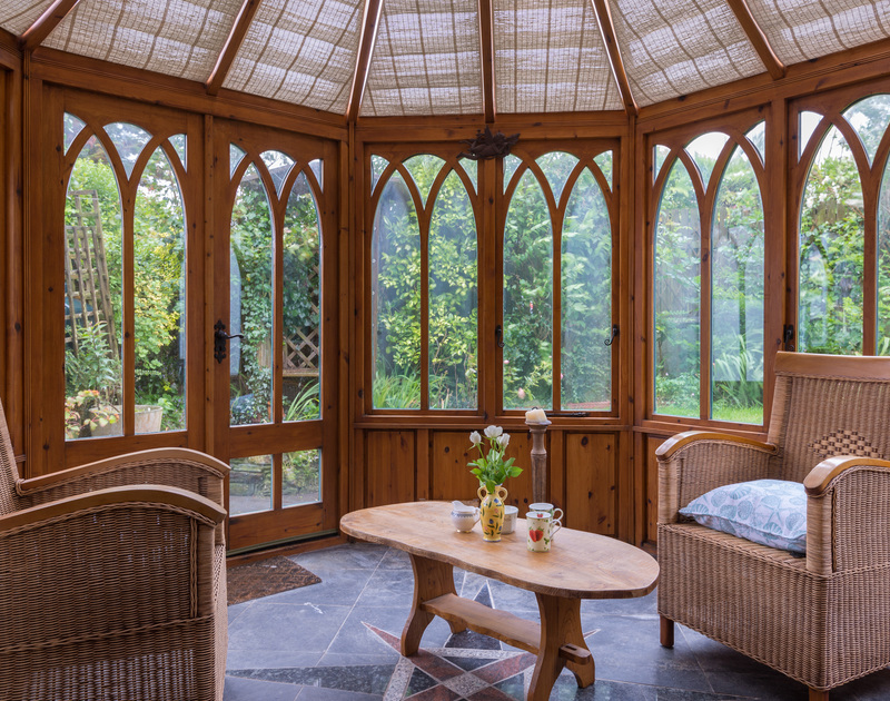 Attractive arched windows flow throughout Fairholme and into the welcoming conservatory, looking over the mature and private garden.